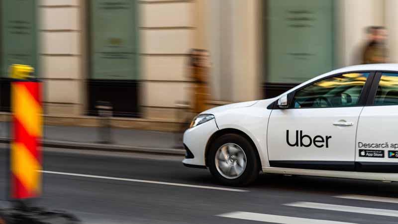 An Uber car driving through the city.