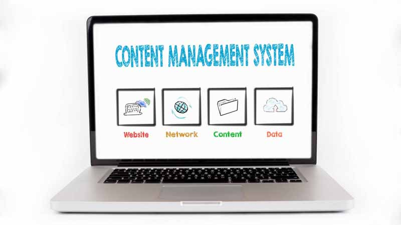 A laptop screen with a Content management system infographic.