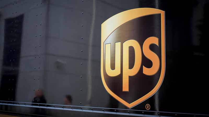 UPS logo on side of delivery truck.