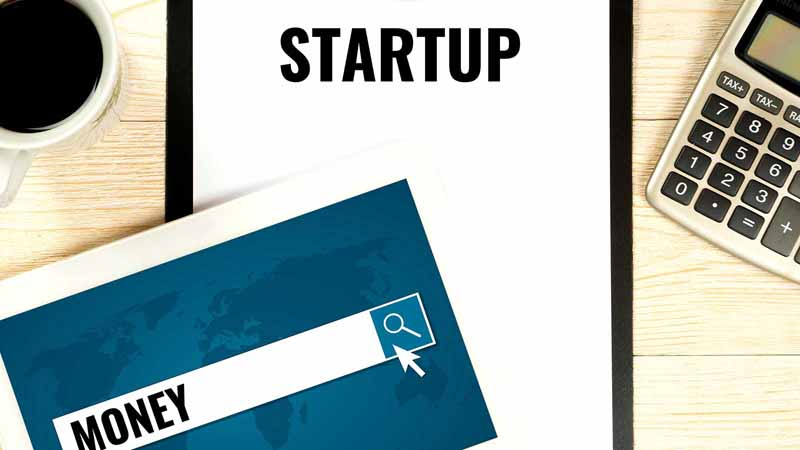 A clipboard that says Startup and a tablet that says Money.