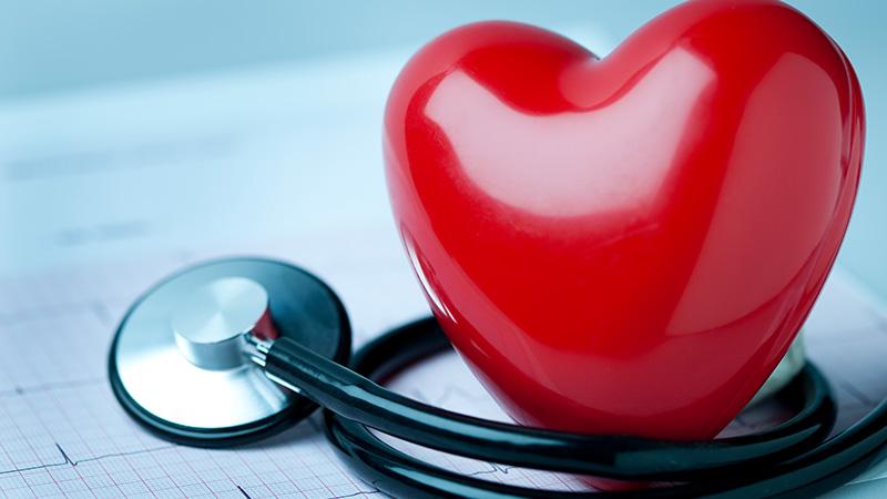 Stethoscope surrounding a heart.