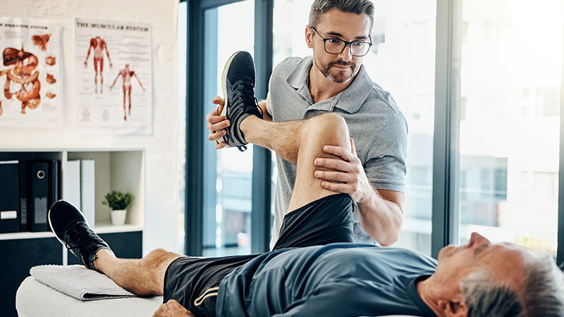 A physiotherapist helping a patient.