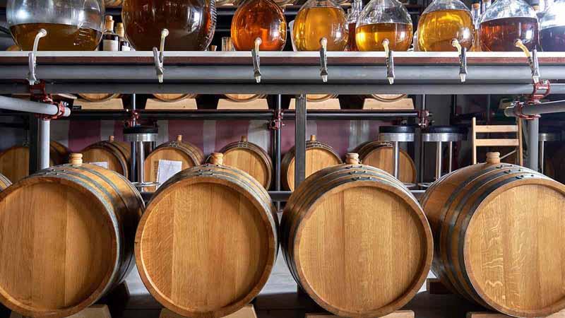 Whiskey barrels in a cellar.