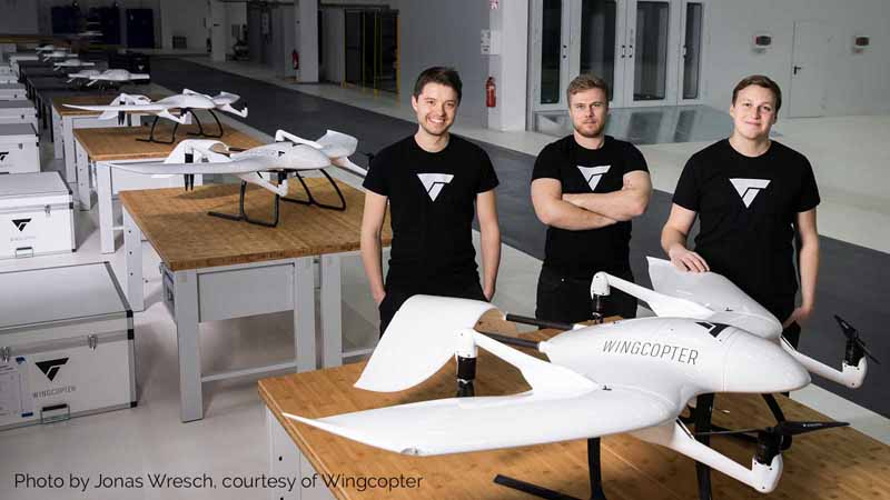 Wingcopter Co-founders Tom Plümmer, Jonathan Hesselbarth, and Ansgar Kadura with a Wingcopter drone.