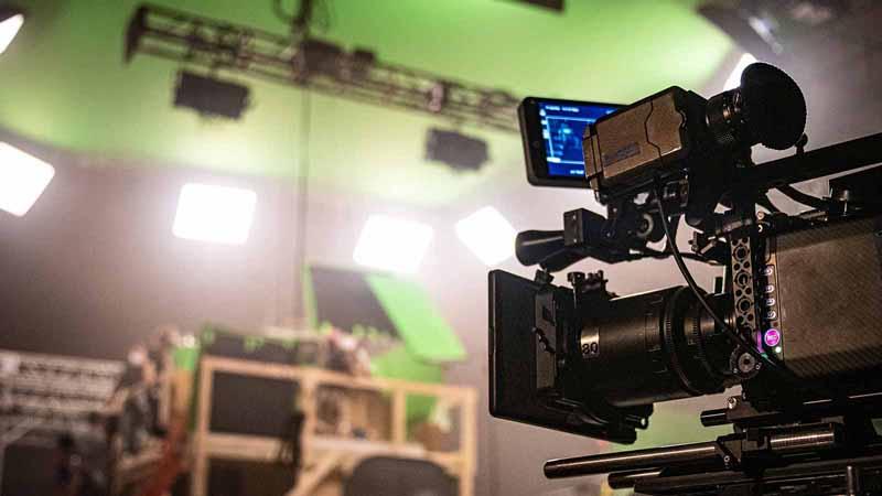 A professional camera on a film set.