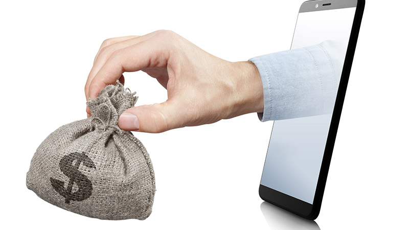A hand holding a bag of money coming out of a phone.