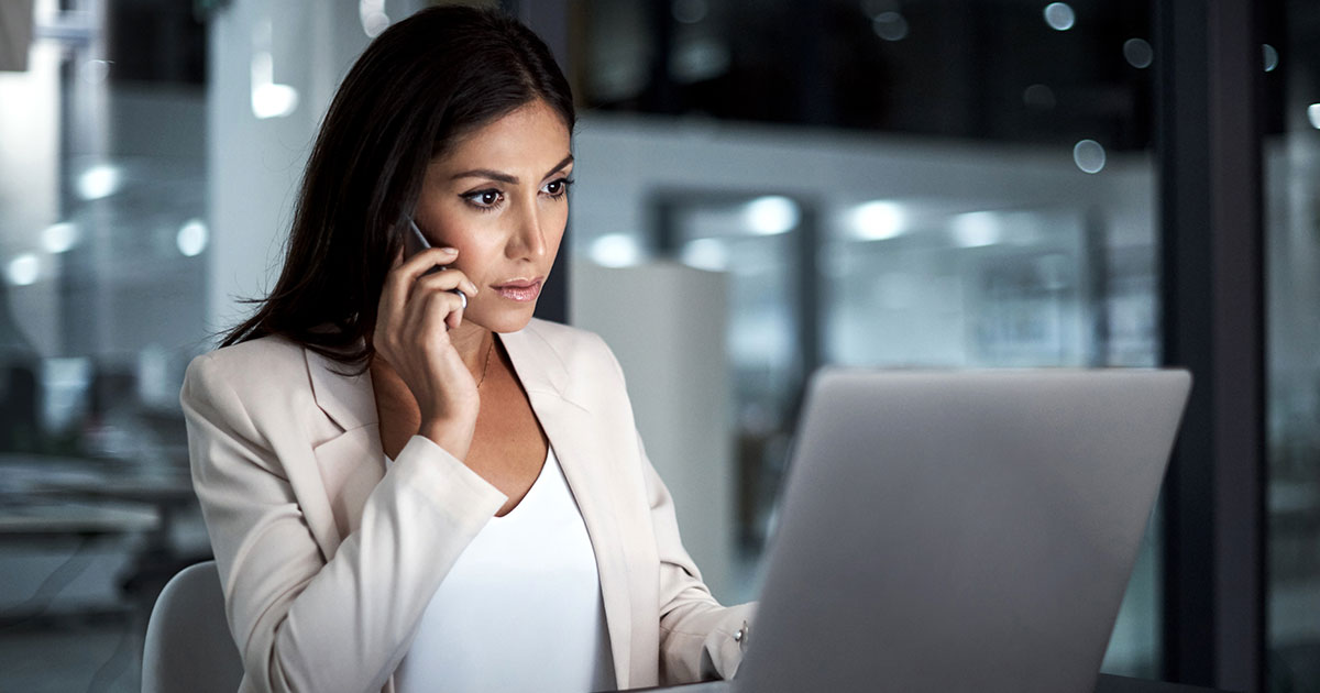 Businesswoman on her phone and laptop.
