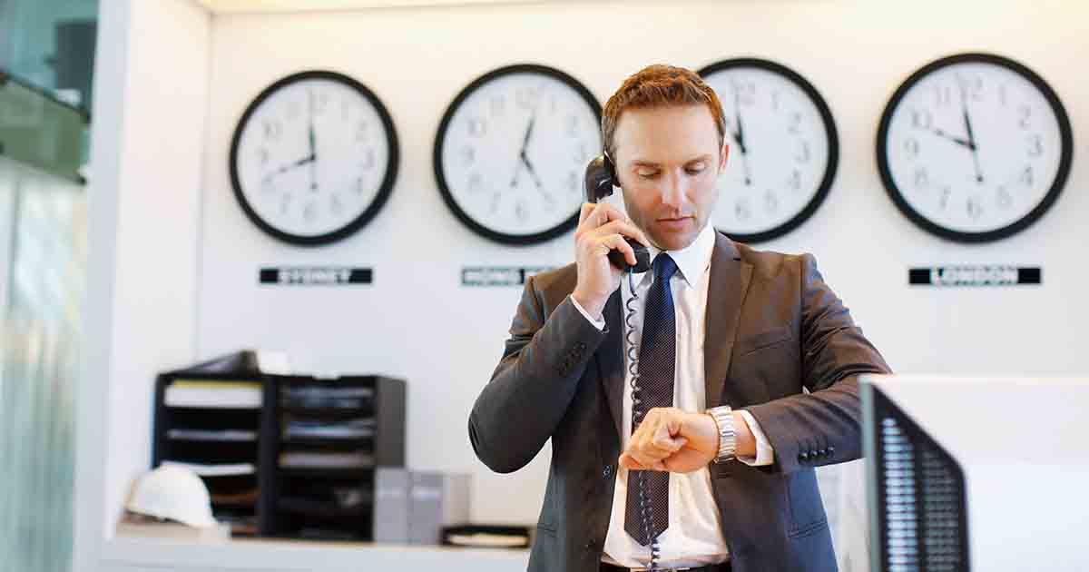 Businessman checking watch.