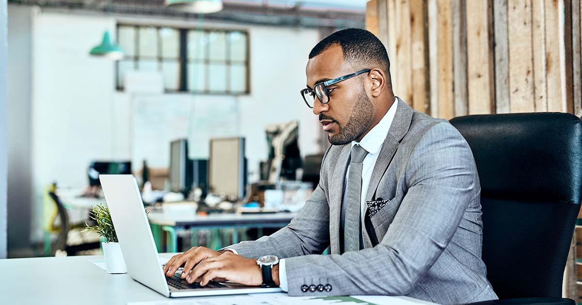 Businessman using laptop.
