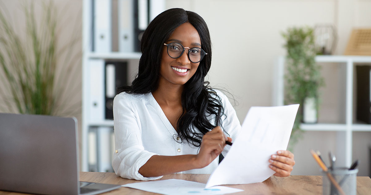 Businesswoman at desk with document.