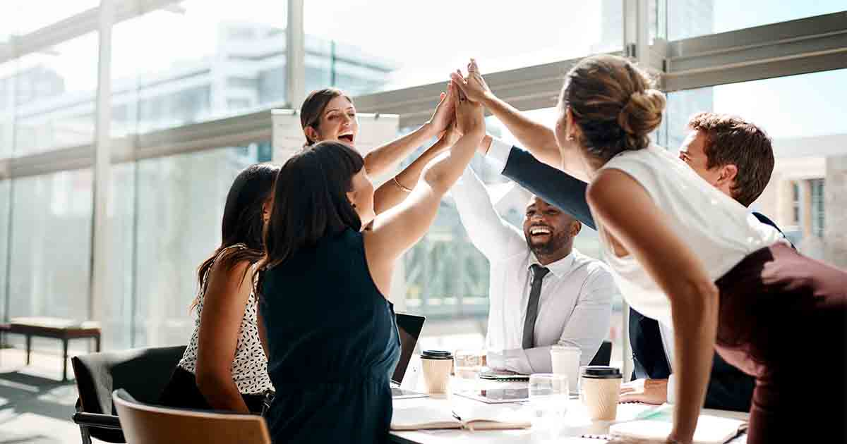 Group of business people high fiving.