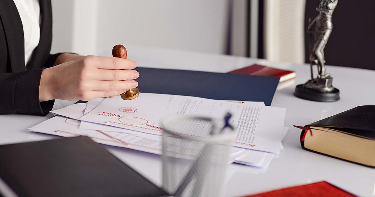 Business woman hand stamping a document.