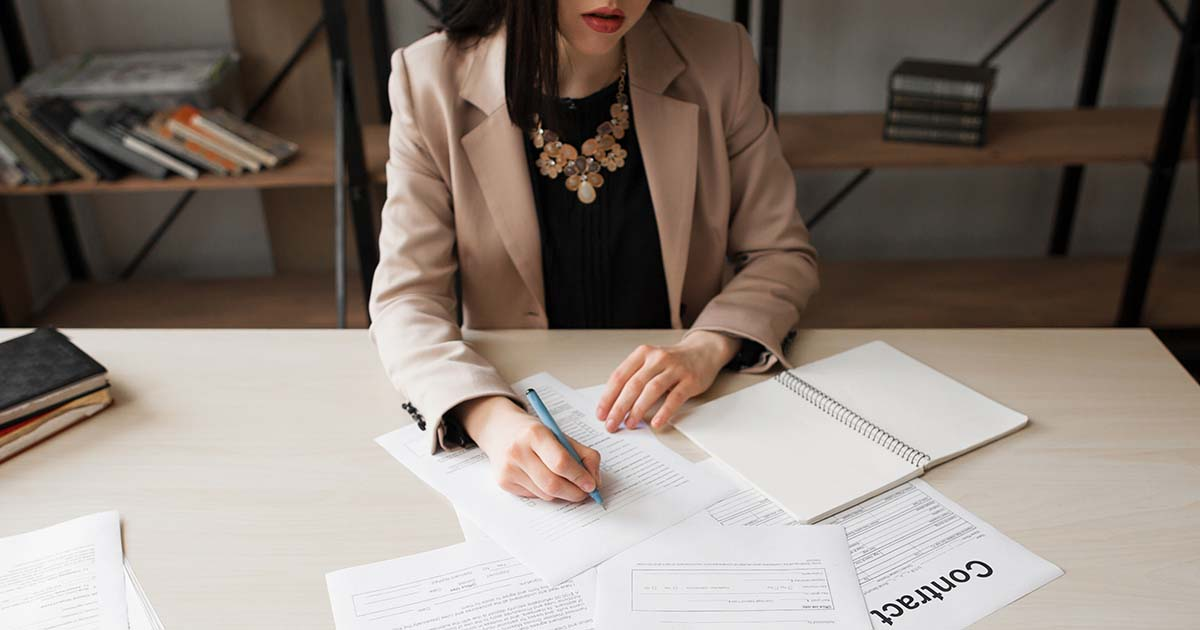 Businesswoman signing contracts.