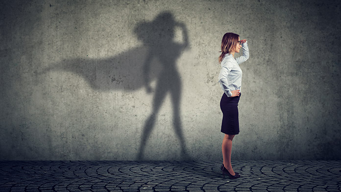 Female entrepreneur with superwoman shadow