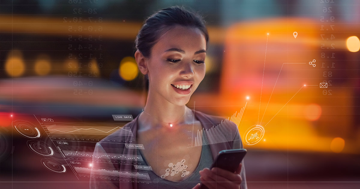 https://cdn.startupsavant.comSmiling woman looking at phone.