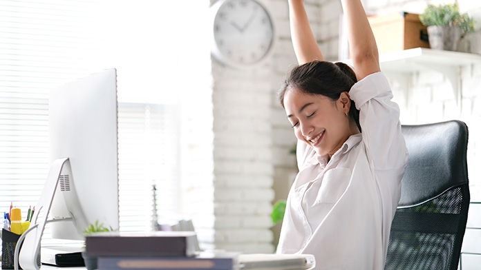 https://cdn.startupsavant.comWoman stretching at her desk.