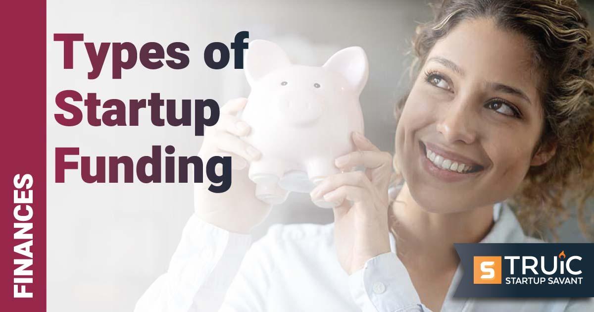 Businesswoman holding a piggy bank.