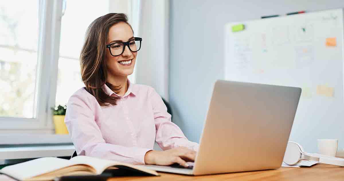 Smiling woman at computer.