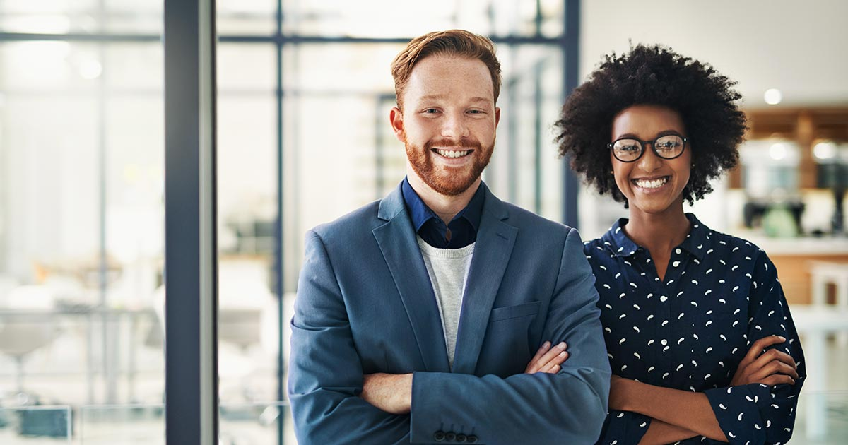 Two entrepreneurs smiling.